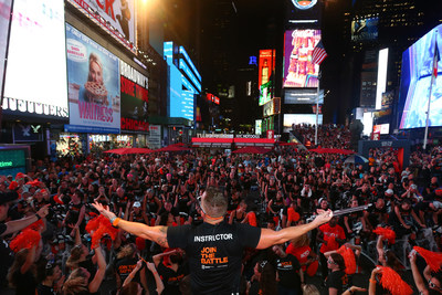 An instructor from Equinox, Cycle for Survival's founding partner, leads riders at the Times Square Takeover to kick off registration and fundraising for Cycle for Survival's 2018 events, which are in 16 cities across the country. (Photo Credit: Mike Stobe, Cycle for Survival)