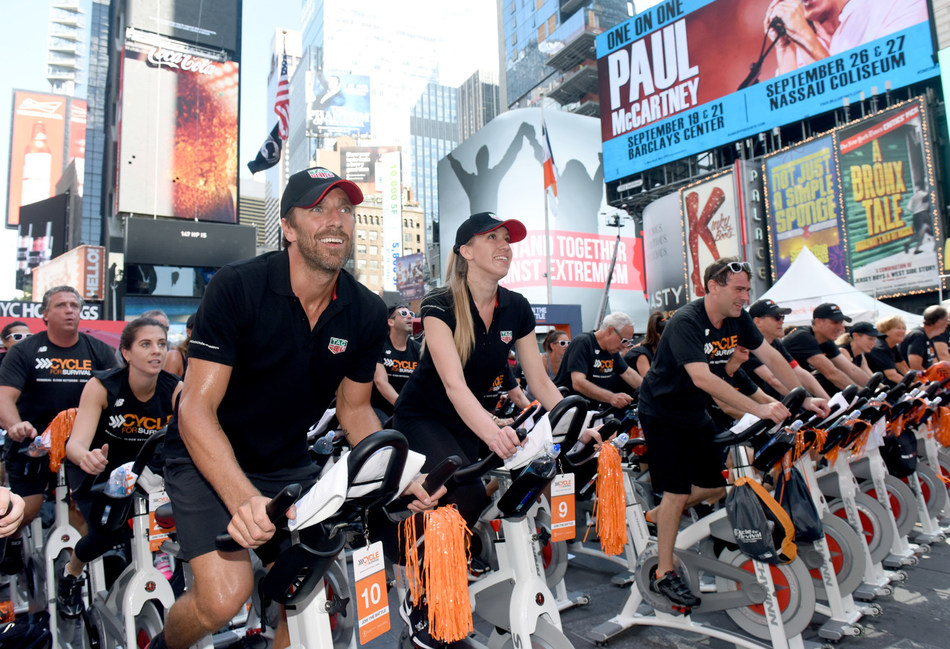 Henrik Lundqvist, goal keeper for the New York Rangers, rides with TAG Heuer at Cycle for Survival's Times Square Takeover to support the movement to beat rare cancers. At the event, TAG Heuer announced their sponsorship as the Official Timepiece and Official Timekeeper of Cycle for Survival. (Photo Credit: Diane Bondareff, Cycle for Survival)