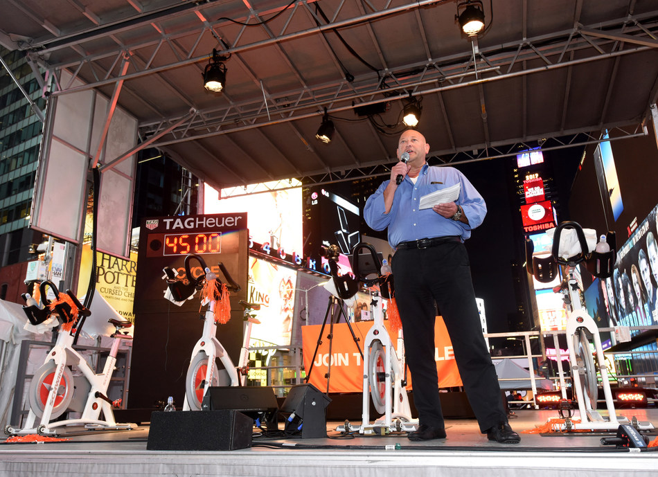 Scott Rosen, President and Chief Operating Officer of Equinox, Cycle for Survival's founding partner, tells riders at the Times Square Takeover why Equinox is committed to the movement to beat rare cancers. The event kicks off registration and fundraising for the indoor cycling rides that will take place in 16 cities across the country in 2018 — all led by Equinox instructors. (Photo Credit: Diane Bondareff, Cycle for Survival)