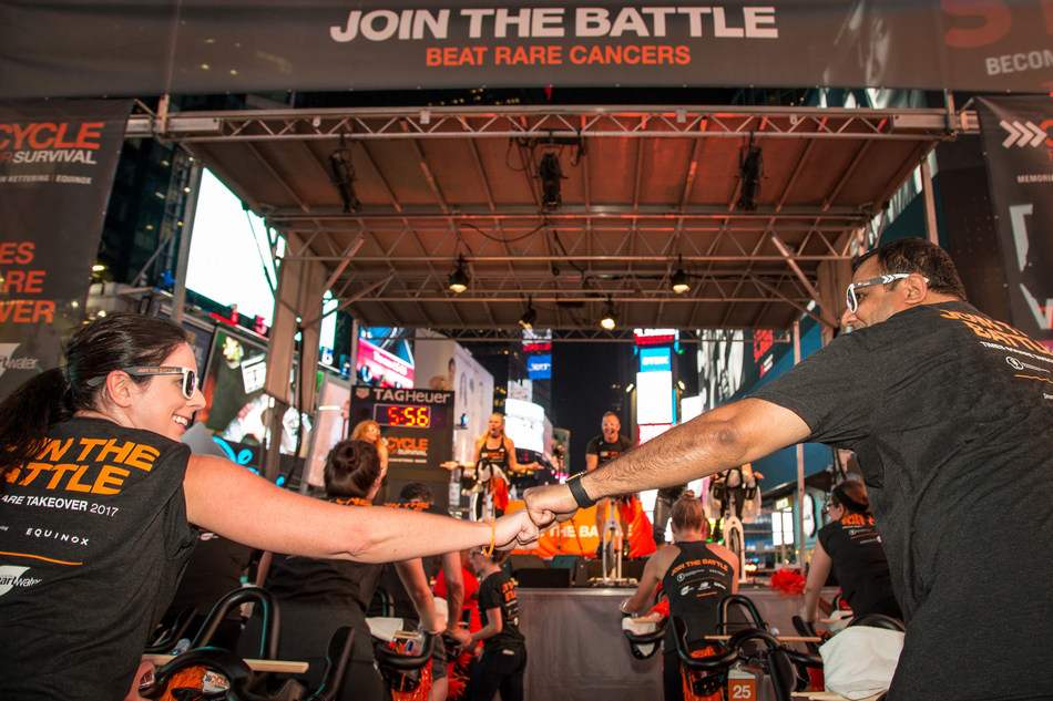 Riders at Cycle for Survival's Times Square Takeover show their support for the movement to beat rare cancers. The event celebrates the launch of registration and fundraising for Cycle for Survival's 2018 indoor cycling rides. Every dollar raised goes to rare cancer research. (Photo Credit: Michael J. Le Brecht II, Cycle for Survival)
