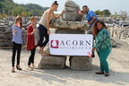 Salute to Invictus athletes from staff of Acorn Stairlifts Canada, who pose with a giant Inukshuk courtesy of Harpers Garden Centre, Ancaster, ON (CNW Group/Acorn Stairlifts)
