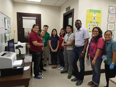 SystemOne Support Specialist Victor Lubuku during a GxAlert implementation in the Philippines, with staff from ministry and funder organizations.