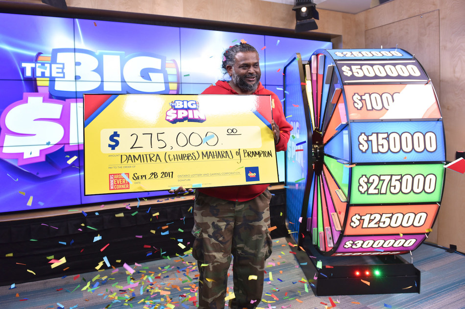 Damitra (Chubbs) Maharaj of Brampton celebrates after spinning THE BIG SPIN Wheel at the OLG Prize Centre in Toronto to win $275,000. Maharaj was the second person to win a top prize with OLG's new INSTANT game – THE BIG SPIN. (CNW Group/OLG)