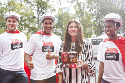 Tiffani Thiessen and her Town House Crackers + Hummus bike brigade geared up to save hungry, on-the-go New Yorkers with a snack!