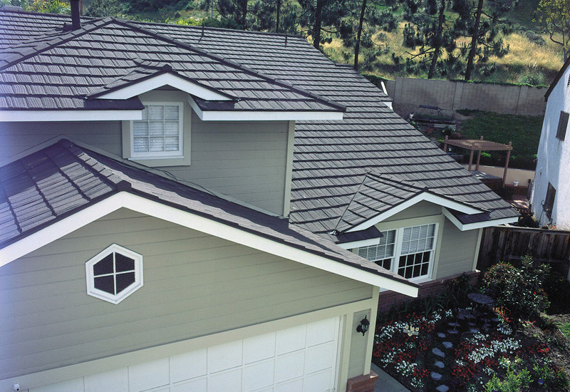 This weathered shake style metal roof is manufactured by MRA member Metro Roof Products. Homeowners are choosing metal roofs because they're attractive, durable and metal adds value to their home. For more information about metal roofing, visit www.metalroofing.com