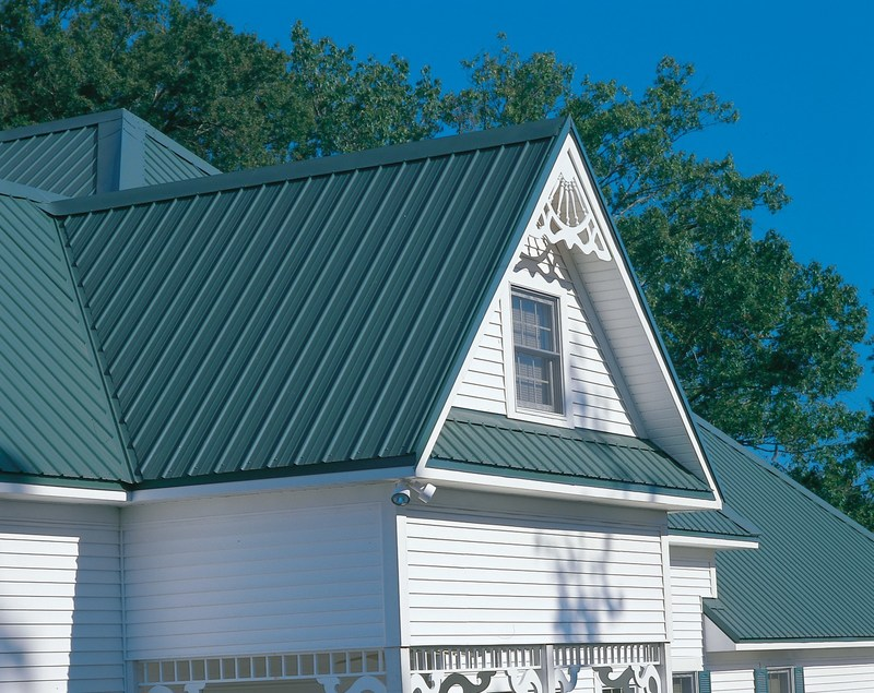 This beautiful standing seam metal roof is manufactured by McElroy Metal. Green standing seam metal roofs are the most popular style of residential metal roofing. For more color options, visit www.metalroofing.com.