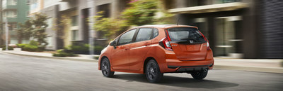 Exterior side view of an orange 2018 Honda Fit.