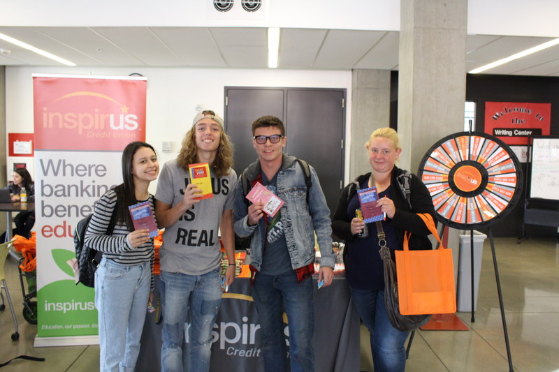 Students at Everett Community College holding the gift cards they won to the student bookstore. The gift cards will be used to offset the high cost of college textbooks.