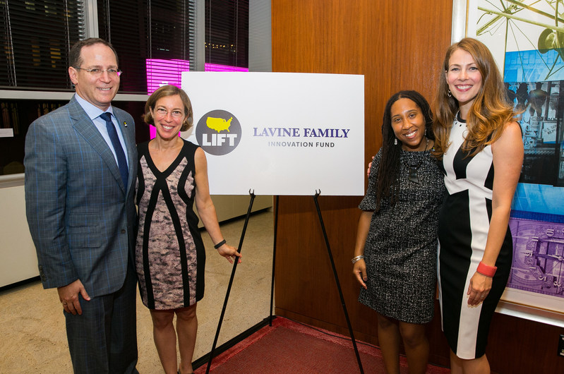 Bain Capital Co-Managing Partner Jonathan Lavine and wife Jeannie pose with LIFT-New York Executive Director Unique Brathwaite and LIFT Co-Founder and CEO Kirsten Lodal at the unveiling of The Lavine Family Innovation Fund, dedicated to innovative solutions for ending intergenerational poverty, Wednesday, Sept. 27, 2017, in New York. (Photo by Kari Otero)