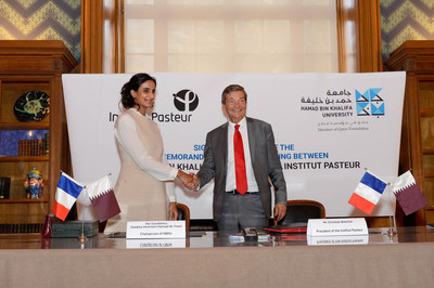 HE Sheikha Hind bint Hamad Al Thani with Christian Bréchot following the signing of the MoU (PRNewsfoto/Hamad bin Khalifa University)