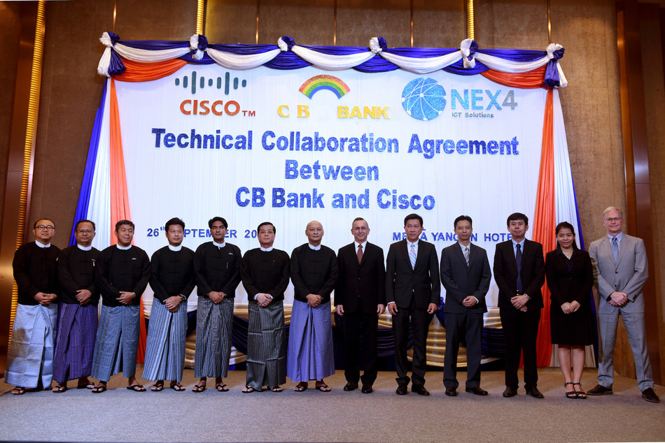 His Excellency, Mr Scot Marciel (middle right), CB Bank CEO, Mr Kyaw Lynn (middle left), with executives from CB Bank, Cisco and Nex4 during today's signing ceremony. (PRNewsfoto/NEX4)