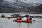 Catherine McKenna, Minister of Environment and Climate Change and Minister responsible for Parks Canada, and Johannes Lampe, President of the Nunatsiavut Government, kayaking in the Labrador Sea (CNW Group/Parks Canada)
