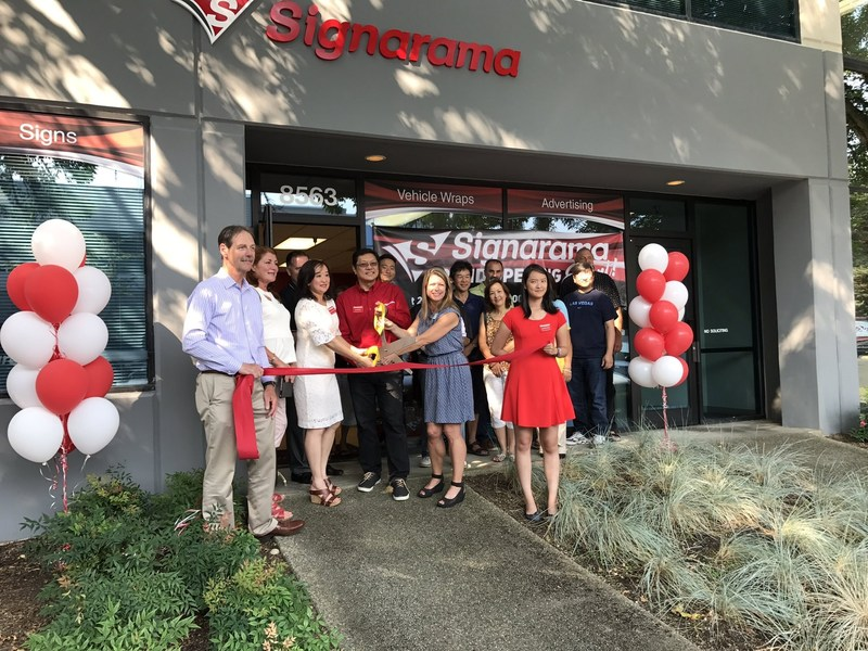 The Signarama® located in Redmond, Washington, celebrates its opening with a ribbon-cutting ceremony.