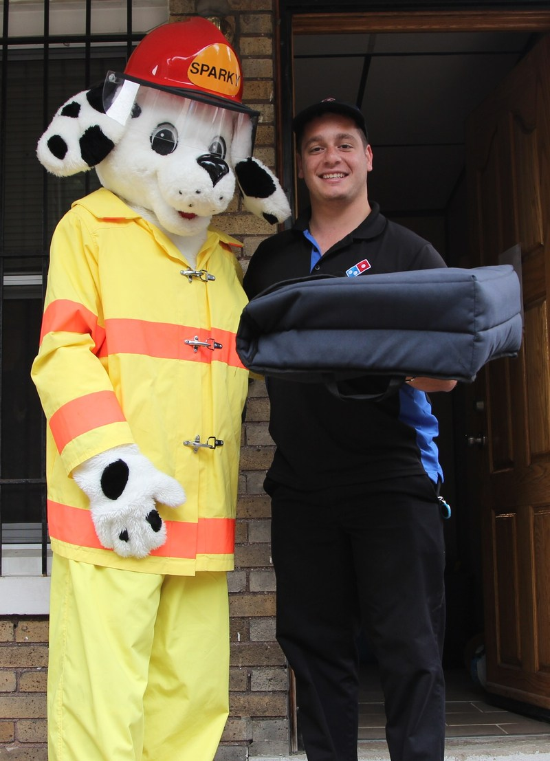 Customers who order from participating Domino's stores throughout the U.S. during Fire Prevention Week may be surprised when their delivery arrives aboard a fire engine. If the smoke alarms in the home are working, the pizza is free. If the smoke alarms are not working, the firefighters will replace the batteries or install fully-functioning detectors.