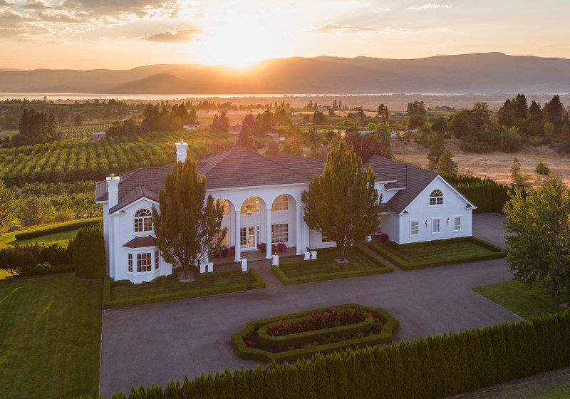 Situated on 14.5 beautiful acres with views of Okanagan Lake, this luxury home in Kelowna, British Columbia is schedule for sale at a live auction on October 5, 2017. The tri-level home was previously asking $6.5 million CAD, but will now be sold without reserve. Platinum Luxury Auctions and The Garage Sale Luxury Auction House are working in cooperation with listing agent Jane Hoffman of Coldwell Banker Horizon Realty for the sale. More at KelownaLuxuryAuction.com.
