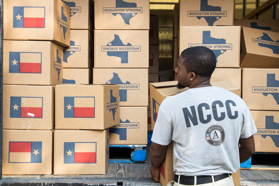 Darien Burrell, an AmeriCorps member serving with the American Red Cross, delivers meals and supplies to Houston residents impacted by Hurricane Harvey. [Corporation for National and Community Service Photo]