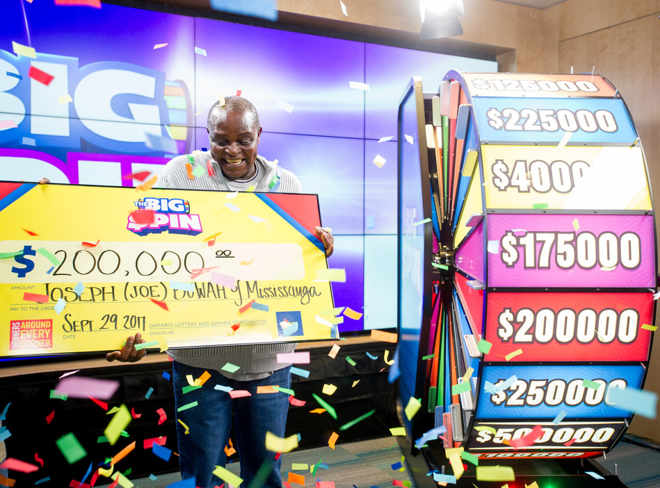 Joseph Buwah of Mississauga celebrates after spinning THE BIG SPIN Wheel at the OLG Prize Centre in Toronto to win $200,000. Buwah was the third person to win a top prize with OLG's new INSTANT game – THE BIG SPIN. (CNW Group/OLG)