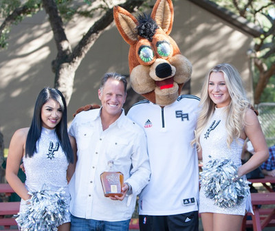 Rebecca Creek Distillery founder & CEO, Steve Ison, pictured with San Antonio Spurs' Silver Dancers and beloved mascot, Coyote, during an event held at the distillery.