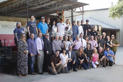Rebecca Creek Distillery employees celebrating the distillery's new partnership with the San Antonio Spurs NBA basketball team.