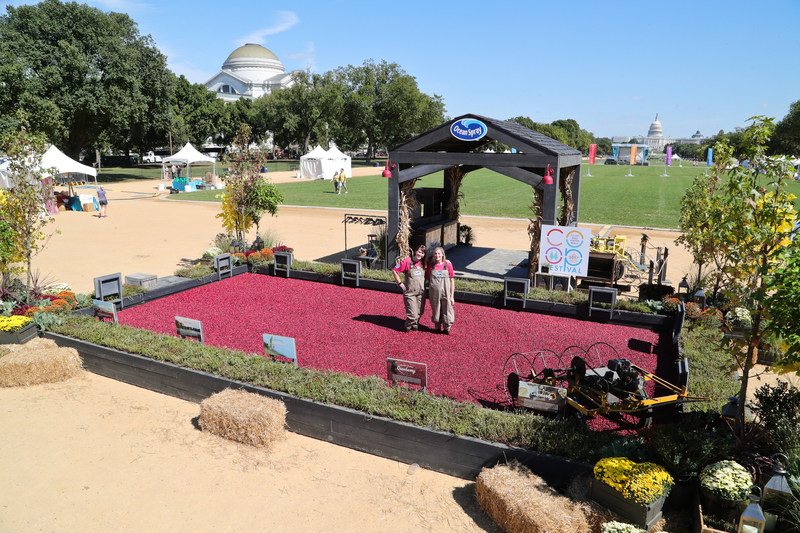 Ocean Spray, a cooperative of more than 700 farmer-owners including Lisl Detlefsen (left) and Alison Gilmore Carr (right), brings its iconic cranberry bog display to the National Co-Op Festival in Washington, D.C. Friday, September 29 through Sunday, October 1 to celebrate the cooperative's roots and the importance and advantages of supporting farmer-owned businesses.