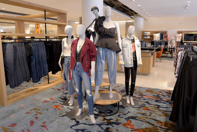 A mannequin grouping of different sizes in the TBD denim department at Nordstrom. The mannequins from L to R are size 0, (white zip top), size 12 (red moto jacket), size 2 (in the back with hat), size 8 (black top) and size 0, (black jeans).