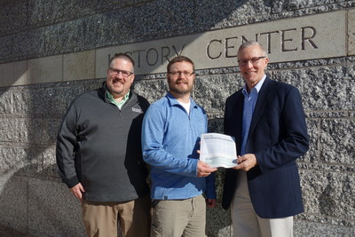 From left to right: Gerald Laming, Retail Marketing Manager at Renewal by Andersen and Justin Miller, Retail Marketing Planner at Renewal by Andersen, present Tom Pfannenstiel, Site Manager at Historic Fort Snelling, with a $10,000 donation from Andersen Corporation for the Minnesota Historical Society's Historical Fort Snelling revitalization campaign.