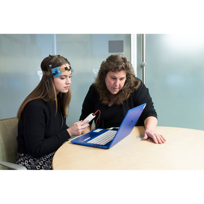 Leigh Charvet, PhD and a member of her research team use the transcranial direct current stimulation (tDCS) equipment