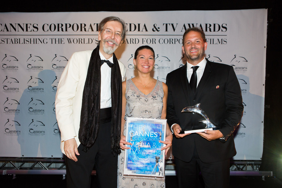 British International School of Chicago, Lincoln Park's Director of Admissions and Marketing, Erin Woodhams, with CEO Jeremy Richter of Richter Studios Accepting Silver Dolphin for the 2017 Cannes Corporate Media & TV Awards Festival. Photo Credit: Felipe Kolm   Warda Network