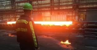 Factory worker in steel mill