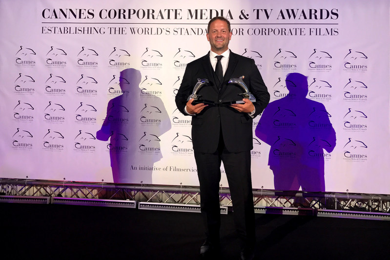 Richter Studios CEO Jeremy Richter onstage with the two Silver Dolphin trophies his company won at the 2017 Cannes Corporate Media and TV Awards Festival. Over 40 countries competed and there were only 174 winners out of 917 entries.