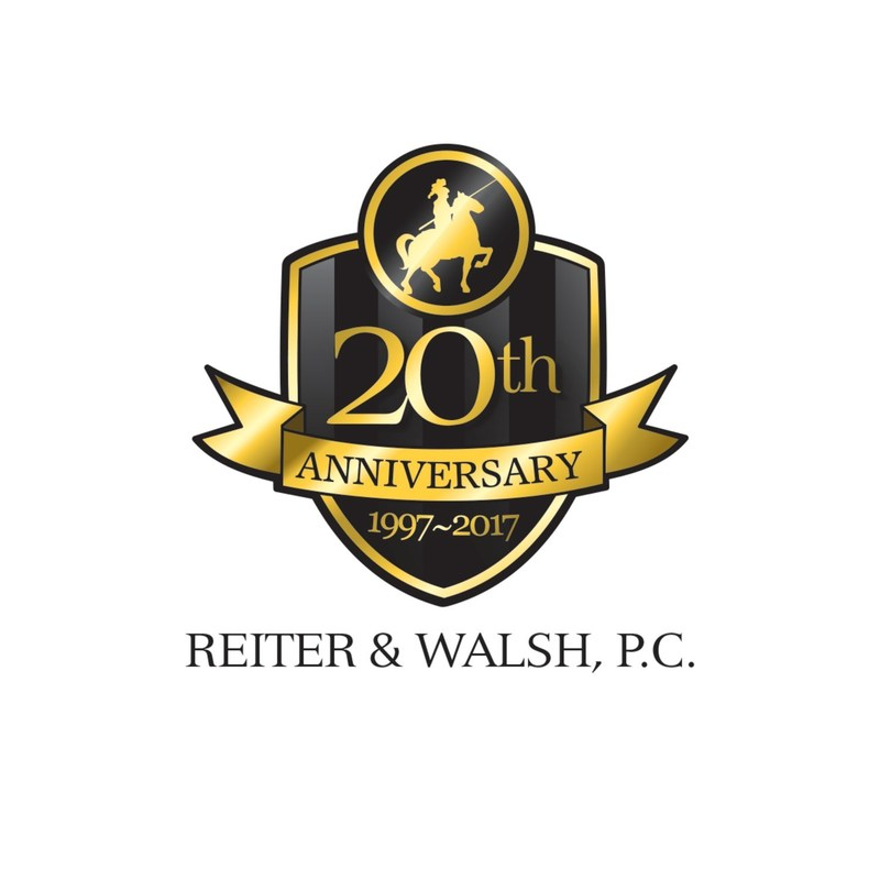 Reiter & Walsh celebrates 20 years with a donation to help disabled children play softball