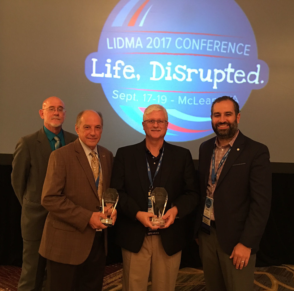 Paperless Solutions Group team receives LIDMA Seal of Approval awards. Pictured from left to right: Paul Carter, Chief Marketing Officer; Thomas Lane, CLU, ChFC, Chief Executive Officer, co- founder; Jeff McCauley - President, Chief Operations Officer; Shervin Eftekhari, LIDMA President