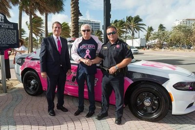 Mike Jackson, Chairman, CEO &  President of AutoNation is joined by City of Fort Lauderdale Mayor Jack Seiler and Police Chief Rick Maglione to launch Breast Cancer Awareness Month. (PRNewsfoto/AutoNation, Inc.)
