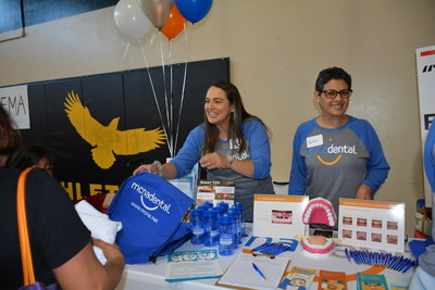 MCNA Dental employees distribute dental kits and backpacks to Houston-area residents