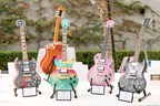 4 hand painted guitars signed by various celebrities were auctioned off to raise money for cancer research