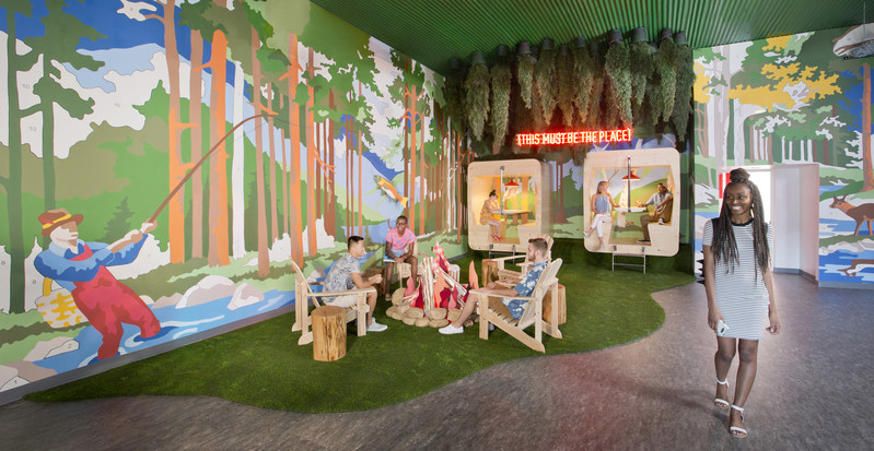 The interior of SCAD's Adler Hall features a 360-degree paint-by-numbers installation designed by alumnus Kyle Millsap (B.F.A. illustration, 2006) that depicts a menagerie of woodland fauna and a vintage Airstream camper. The vignette includes a fabric campfire created by alumna Trish Andersen (B.F.A. fibers, 2005) and a sound installation by alumnus Cooper Skinner (B.F.A. sound design, 2010, M.F.A. sound design, 2013). Image courtesy of SCAD.