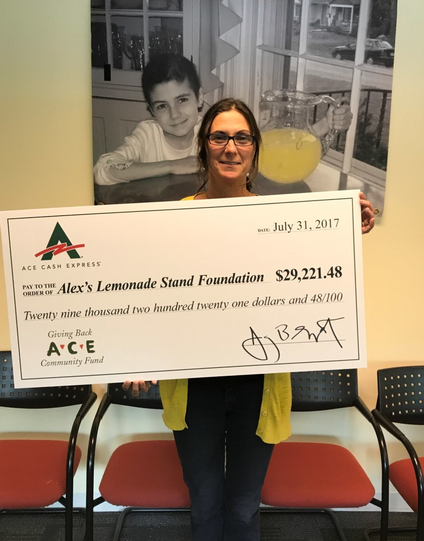Liz Scott, Co-Executive Director of the Foundation and mother of founder Alex Scott accepts ACE's donation