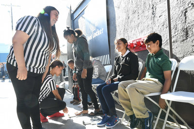 Foot Locker partners with Fred Jordan Missions for the 29th consecutive year donating more than 5,000 shoes to children in need on Skid Row in Los Angeles on Oct. 5, 2017.