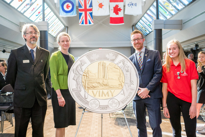 From left: Military Museums Senior Curator Rory Cory, Royal Canadian Mint President and CEO Sandra Hanington, Vimy Foundation Executive Director Jeremy Diamond and Bishop Carroll High School Student Rachel Barlow unveil a $2 circulation coin commemorating the 100th anniversary of the Battle of Vimy Ridge at the Military Museums in Calgary, AB (October 5, 2017). (CNW Group/Royal Canadian Mint)