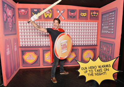 Tyler Posey poses in the Nissin Cup Noodles Lair at the New York Comic Con Heroes After Dark party with a one-of-a-kind Cup Noodles sword.
