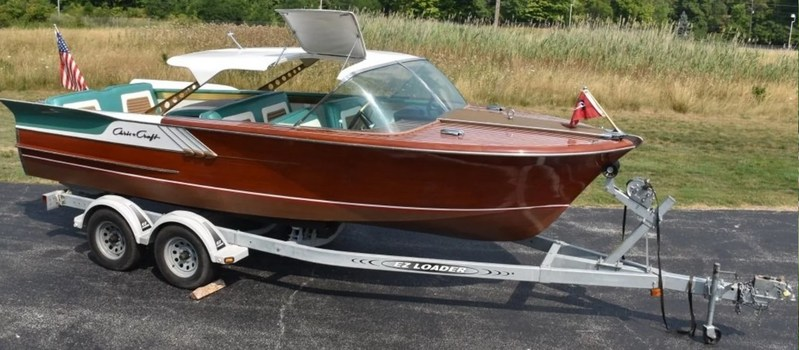 1961 Chris-Craft Continental wood boat with fins, 21ft long, one of only 96 made and only a dozen extant, loaded with options, complete with tandem-axle trailer. Est. $30,000-$40,000