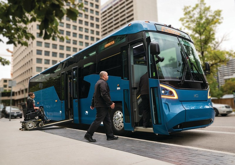 MCI ( Motor Coach Industries) unveils first of its kind low entry ADA accessibility on all new  people-centered coach for public transit. (CNW Group/New Flyer Industries Inc.)
