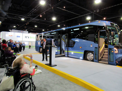 MCI President Ian Smart unveils all-new 54-passenger  D45 CRT LE with a low entry mid-door and adjoining vestibule seating for five, or two passengers using mobility devices - a breakthrough design in ADA accessibility - at APTA EXPO 2017 Oct. 9-11 in Atlanta, GA. (CNW Group/New Flyer Industries Inc.)