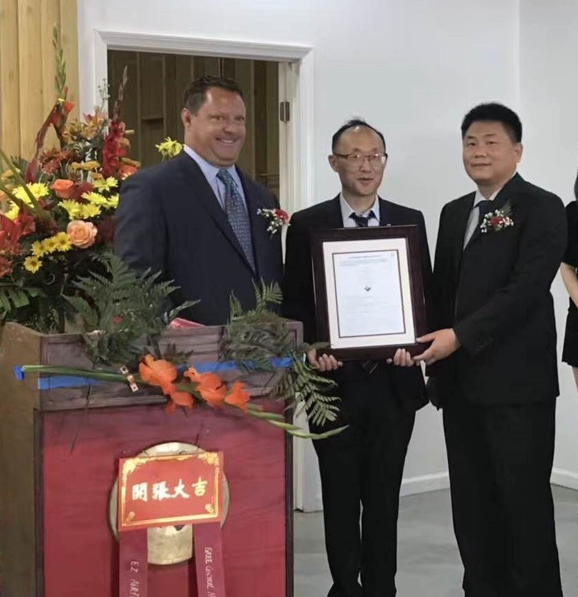 On October 7, 2017 Mr. David Kuehn, VP of Sales for UL's Commercial & Industrial business presented a certificate to Mr. George Gao, CEO of Gree Central HVAC Supply and Mr. OuYang Jun, Gree China Sales Manager.