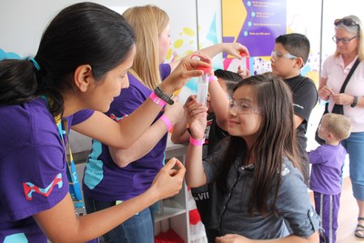 MilliporeSigma employees teach hands-on STEM lessons inside the Curiosity Cube™