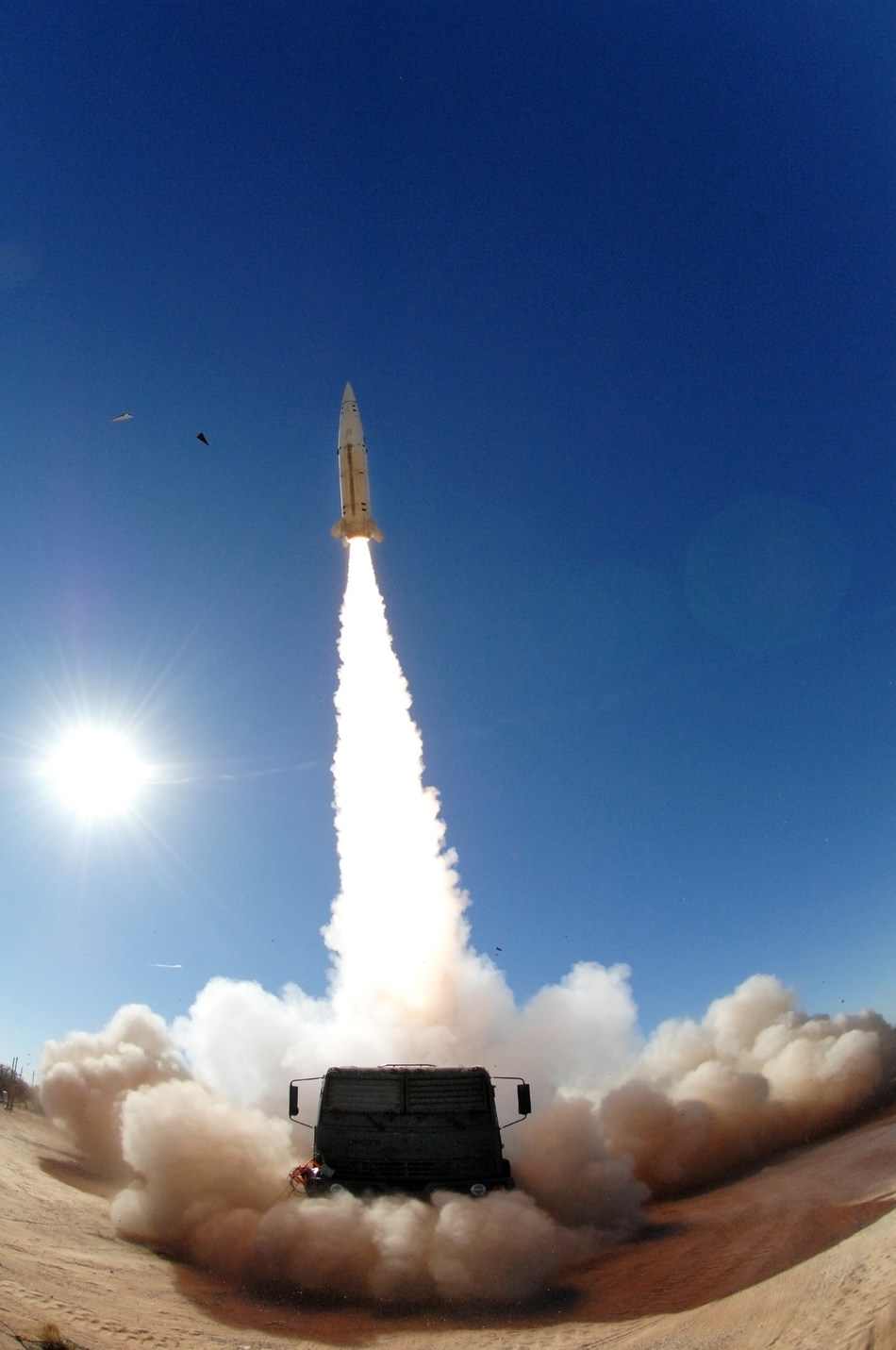 A Lockheed Martin ATACMS missile blasts away from its launcher at White Sands Missile Range, New Mexico, during a flight test.