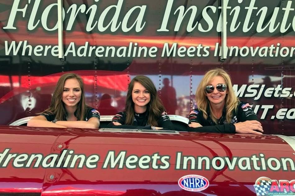 "Speed, STEM, support: The women of Larsen Motorsports. From left, Kathryn ""Kat"" Redner, Paige Sanchez and Elaine Larsen stand with Larsen Motorsports' Florida Institute of Technology jet dragster."