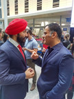 Minister Navdeep Bains and Tony Chahine, CEO of Myant, discussing innovation and advanced manufacturing in Canada. Photo credit: Melony Jamieson, Get it Done (CNW Group/Myant Inc.)