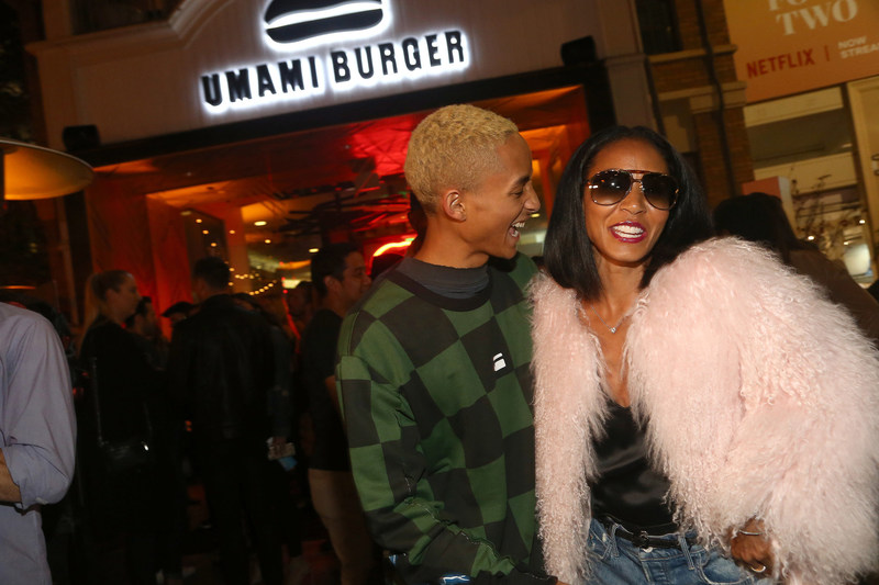 Jaden Smith and Jada Pinkett Smith attend the Umami Burger x Jaden Smith Artist Series Launch Event at The Grove on October 11, 2017 in Los Angeles, California.