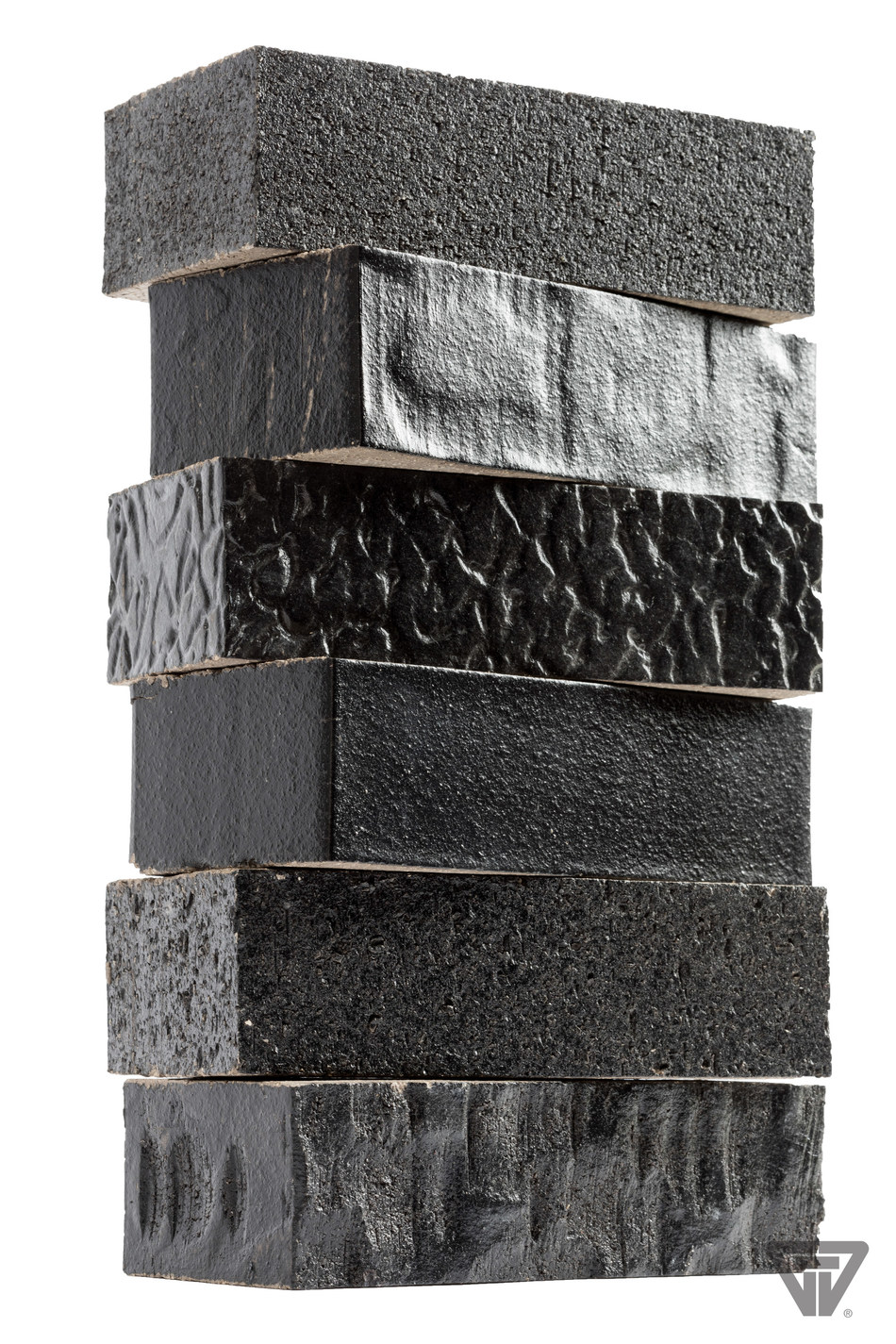 With six total surface texture options, the product offering from Glen-Gery's Hanley Plant is one of the most diverse in the industry, offering the the utmost design flexibility.   A different texture has been applied to the same product: Black Pearl. Textures from top to bottom are: wirecut, stone rolled, warble, smooth, rough and craftsman.